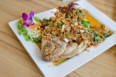 Deep fried fish with herb salad (Thai dish and healthy food) Royalty Free Stock Image