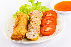 Deep fried fish rool. Deep fried fish rool with tomato,lettuce and sauce Stock Photos