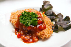Deep fried fish steak with sauce and vegetables Royalty Free Stock Photos