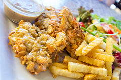 Deep-fried fish steaks with almond flakes Royalty Free Stock Photography