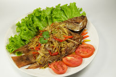 Deep fried fish with sweet chilli sauce in white dish Royalty Free Stock Photography
