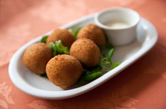 Deep fried fish tapas with salad. Deep fried fish ball tapas with a tasty dip and salad Stock Photo