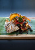 Deep fried fish with Thai herbs. Stock Images