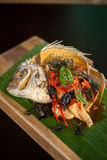Deep fried fish with Thai herbs. Stock Image