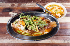 Deep fried fish topped with sweet and sour sauce. Thai food. Sel Stock Photo