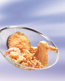 Deep fried food. A mixture of deep fried chicken wing, fish and prawn Royalty Free Stock Photos