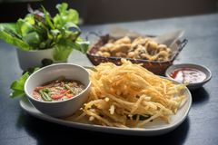 Deep Fried Green Papaya Salad Som Tum Tod named in Thai with Som Tum dressing, sour and spicy tasty.Thai fusion recipe the most royalty free stock photography