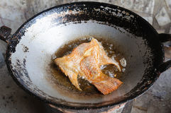 Deep fried half Tilapia fish fried. In frying pan Stock Photos