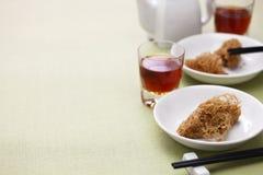 Deep fried honeycomb taro dumplings. Chinese dim sum and shaoxing wine Royalty Free Stock Photos