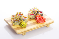 Deep-fried Japanese roll with red caviar avocado and unagi sauce Royalty Free Stock Image