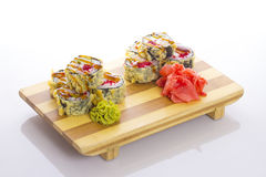 Deep-fried Japanese roll with red caviar avocado and unagi sauce Royalty Free Stock Images