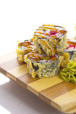 Deep-fried Japanese roll with red caviar avocado and unagi sauce Stock Photography