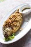 Deep fried java barb fish with garlic Stock Photos