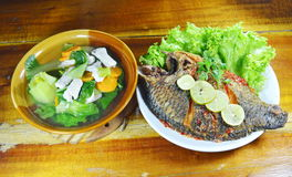Deep fried mango fish dressing sweet chili sauce and mixed vegetable soup Stock Photo