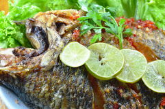 Deep fried mango fish dressing sweet chili sauce and slice lemon Stock Photos