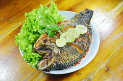 Deep fried mango fish dressing sweet chili sauce and slice lemon Stock Photography