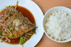 Deep fried mango fish head dressing ginger and soy sauce with plain rice Royalty Free Stock Photos