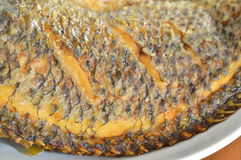 Deep fried mango fish skin texture on dish Stock Photos