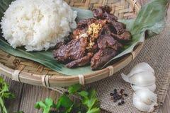 Deep fried marinated beef Thai Style on banana leaf Stock Photography