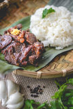 Deep fried marinated beef Thai Style on banana leaf Stock Photos