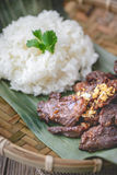 Deep fried marinated beef Thai Style on banana leaf Stock Images