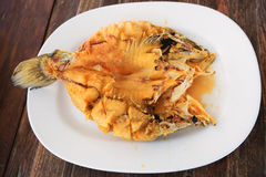 Deep-Fried Marinated Snapper with Sweet Fish Sauce. Served on white plate on wooden table stock images