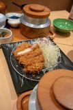 Deep fried meat cutlet coated with flaky panko bread crumb and s Royalty Free Stock Photography