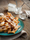Deep-fried pastry on wooden table. Royalty Free Stock Image