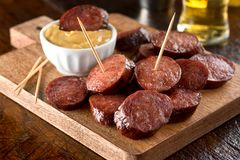 Deep Fried Pepperoni. Delicious pub style deep fried pepperoni on a wood serving board Royalty Free Stock Photo