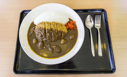 Deep-fried pork cutlet curry with rice. Served in a food tray Stock Photography