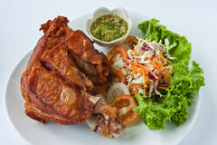 Deep fried pork leg. Modern thai food Deep fried pork leg served with sour and spicy dipping sauce Stock Image