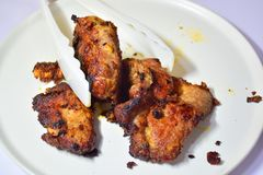 Deep Fried Pork - Place in a container. Spiced Pork Fry in boiling oil, rinse thoroughly until the skin burns Stock Photos