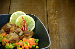 Deep Fried Pork Rib with Vegetable. Combine lemon grass, galangal soup consists of onions or garlic burn some recipes use onion, parsley, mint or coriander Stock Photos