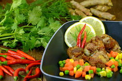 Deep Fried Pork Rib with Vegetable. Combine lemon grass, galangal soup consists of onions or garlic burn some recipes use onion, parsley, mint or coriander stock photo