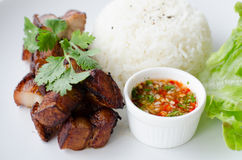 Deep fried pork with rice and chili sauce Royalty Free Stock Photography