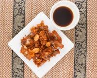 Deep fried pork tendons with black sauce Royalty Free Stock Photos