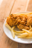 Deep fried potato chips and fried chicken Stock Images