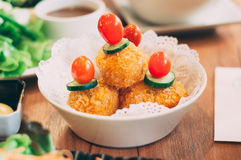 Deep fried potato croquette. On wooden table Stock Image