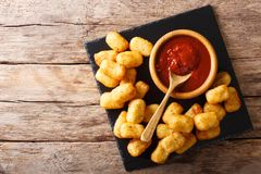 Deep-fried Potato Tater Tots and ketchup close-up. horizontal to. Deep fried Potato Tater Tots and ketchup close-up on the table. horizontal top view from above Stock Photo