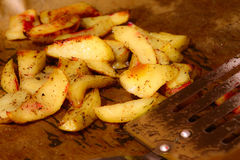 Deep-fried potatoes. Meat dishes complement the roast potatoes Stock Images