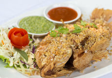 Deep Fried Red Tilapia with Garlic and Pepper. Royalty Free Stock Image
