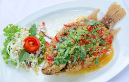 Deep fried red tilapia topped with sweet and sour sauce on top, Stock Image
