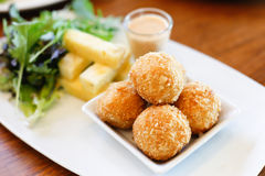 Deep Fried Rice Balls with Salmon and Cream Cheese. Garnished on Royalty Free Stock Images