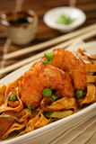 Deep fried scampi with Asian noodles and green pea Stock Image
