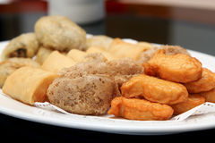 Deep Fried set, Dim Sum, Chinese cuisine. Deep Fried Fish Bean Cake, Deep Fried Mash Taro, Deep Fried Spring Roll, Deep Fried  Chinese Chives in a white dish Royalty Free Stock Photos