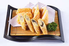 Deep fried Shishamo and crab stick on wooden dish isolated on wh Stock Images