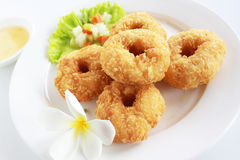 Deep Fried Shrimp Cake. Deep Fried Shrimp Cake on white background decorated with flower Stock Photo
