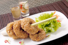 Deep-fried shrimp cakes thai food. Deep-fried shrimp cakes with sauce Royalty Free Stock Photos