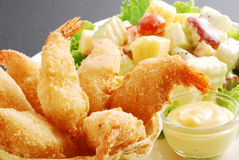Deep fried shrimp served with mixed fruit salad and sweet cream. Fusion dish, deep fried shrimp served with mixed fruit salad Royalty Free Stock Photo