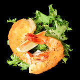 Deep fried shrimps with lettuce isolated on black Stock Photography